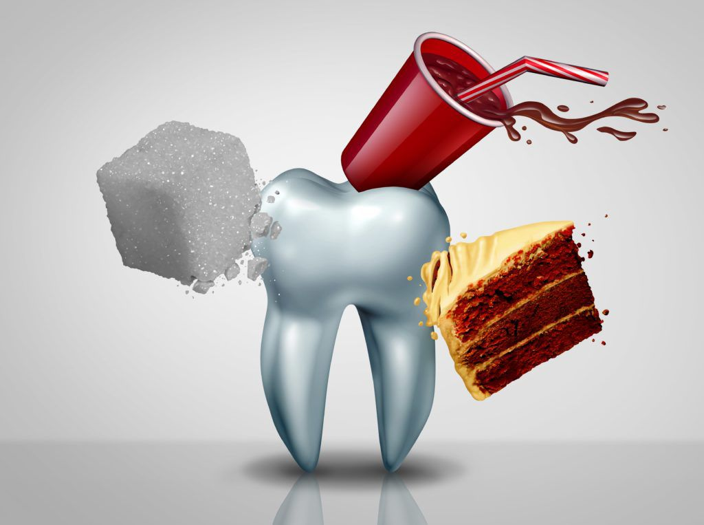 Giant tooth being attacked by soda, cake, and sugar