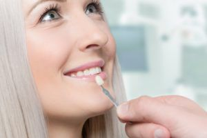 Woman having her teeth color matched for veneers