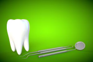 Giant tooth and dental tools on a green background
